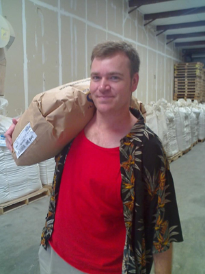 Chris carries a bag of two-row pale malt.