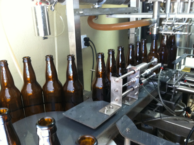 22-Ounce Bombers of Cocoa Beach Pale Ale being bottled.